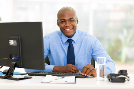 smiling african american office worker looking at the camera