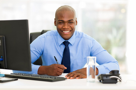 happy african corporate worker working in office Stock Photo