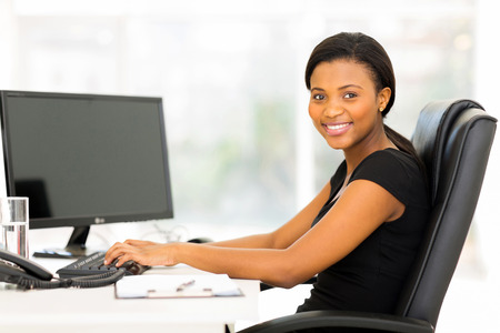 beautiful female african corporate worker working in office photo