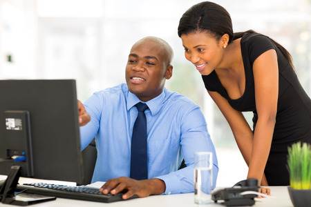 african business woman: handsome african businessman and secretary working in the office