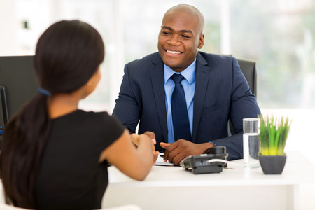 black handshake: successful african american businessman handshaking with client in office Stock Photo