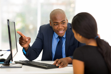 happy african businessman meeting with client in office Stock Photo