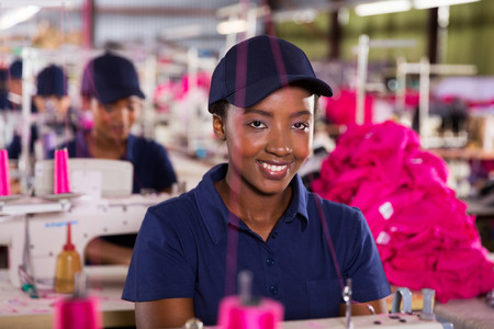 happy female african textile worker in factory photo