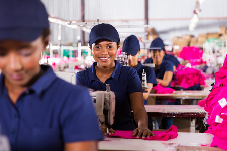 happy african textile workers on the production line photo