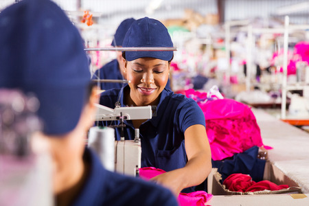 textile industry: african textile factory workers on production line