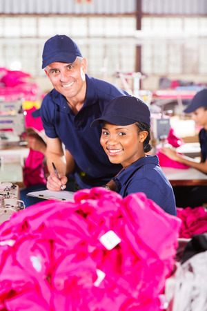quality controller: pretty textile factory worker and quality controller looking at the camera