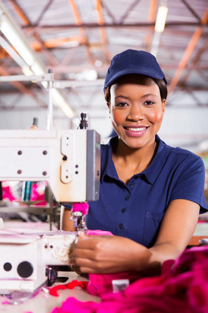 portrait of beautiful african textile factory machinist photo