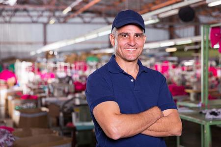 portrait of happy senior clothing factory owner Stock Photo