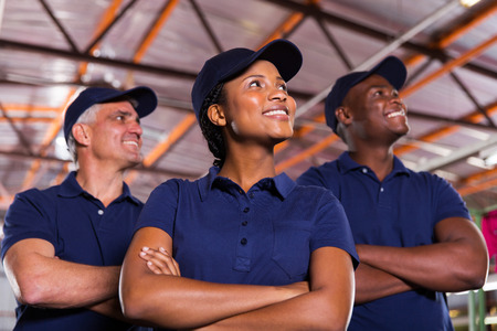 group of textile co-workers looking up photo