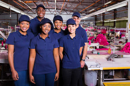 production area: group of textile workers in production area Stock Photo