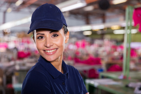attractive female textile worker portrait in factory photo