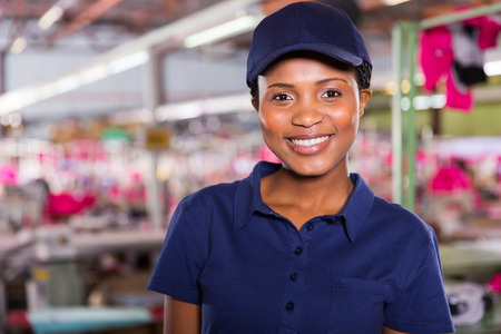 portrait of happy female clothing factory worker
