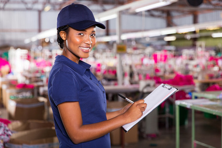 production area: young female african textile factory worker in production area Stock Photo