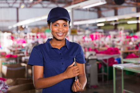 female african clothing factory supervisor with clipboard photo