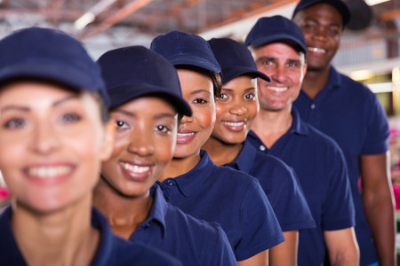blue collar: group of modern textile workers team closeup Stock Photo
