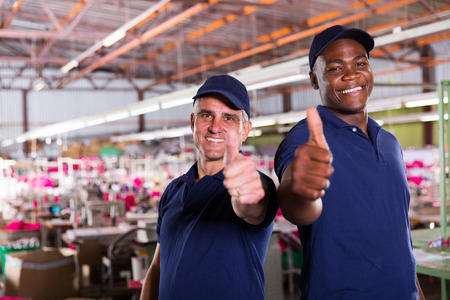 cheerful factory supervisors giving thumbs up photo
