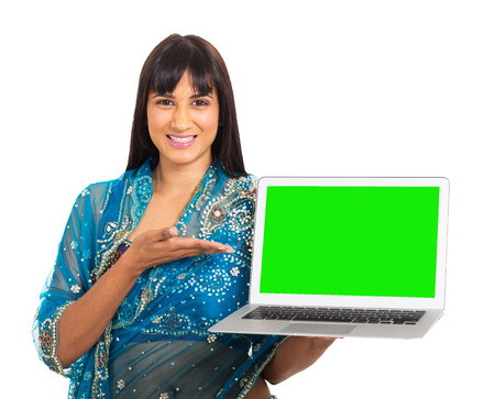 portrait of indian woman presenting green laptop screen on white background photo