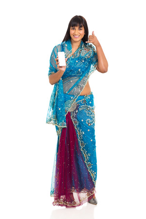 cheerful indian woman doing call me sign and holding smart phone photo