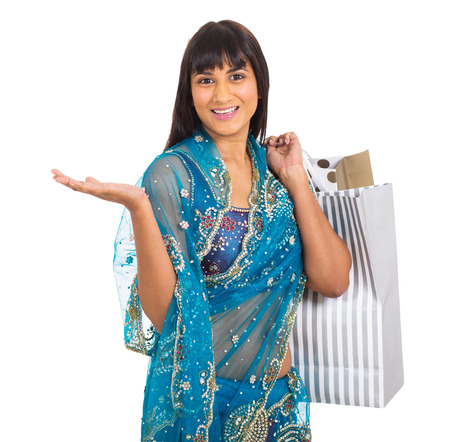 beautiful indian woman in traditional clothes carrying shopping bags on white background photo