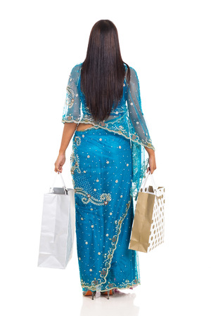 rear view of indian woman holding shopping bags isolated on white background photo