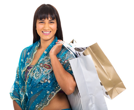 portrait of attractive indian woman carrying shopping bags photo
