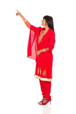 side view of indian woman pointing empty space photo