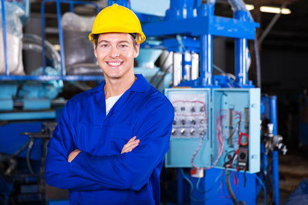 portrait of young technician with arms crossed Stock Photo