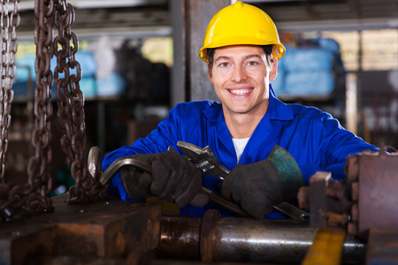 portrait of industrial manual worker in workshop photo