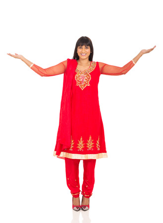 happy indian woman with arms outstretched photo