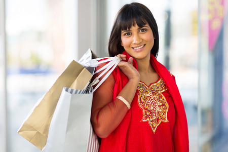 cheerful indian woman shopping in mall Stock Photo