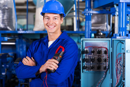 cheerful young industrial technician looking at the camera photo