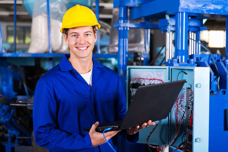 plant: portrait of male engineer with laptop computer in factory Stock Photo