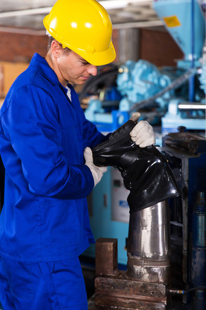 skilled operator: young factory worker making gumboot