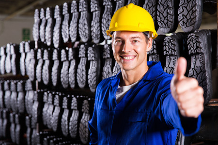 gum boots: cheerful gumboot factory worker giving thumb up