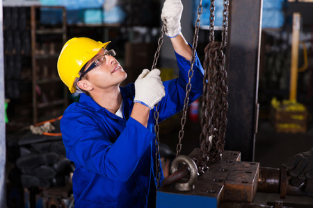 skilled labour: skilled male industrial worker at work