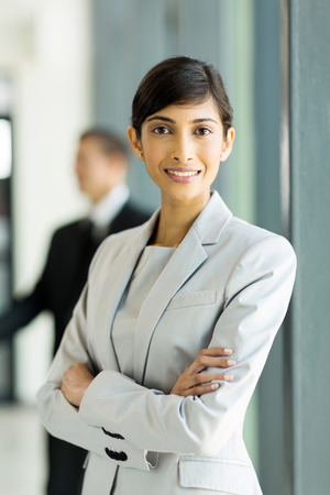 pretty indian business woman with arms crossed