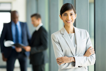 happy young indian businesswoman in modern office