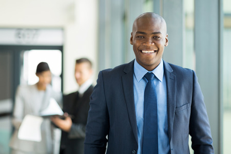 african businessman: handsome young african american businessman in office