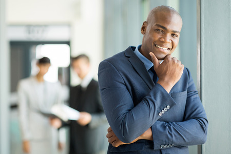 african businessman: happy african businessman in modern office