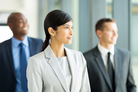 pretty indian businesswoman with group of businesspeople on background photo