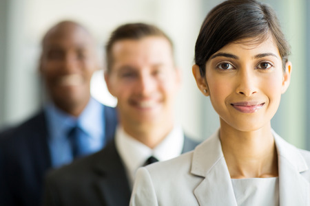 indian ethnicity: beautiful indian businesswoman standing in a row with colleagues