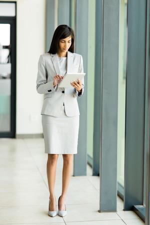 modern indian entrepreneur using tablet computer photo