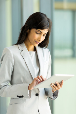 contemporary woman: professional indian businesswoman working on tablet computer