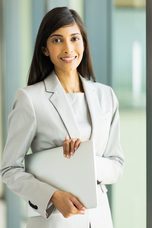 executive woman: beautiful young corporate worker in modern office