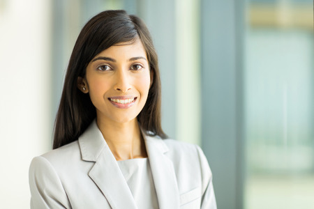 woman close up: close up portrait of young indian business woman in modern office Stock Photo