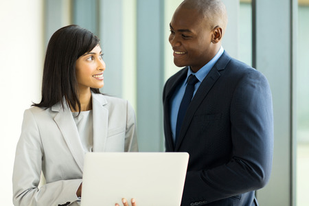 black man white woman: multiracial businesspeople using laptop computer in office Stock Photo