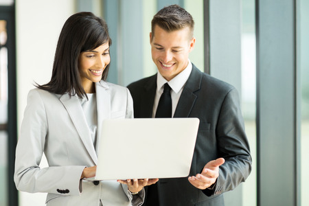 happy business team using laptop Stock Photo