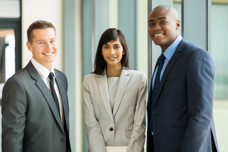 group of multicultural businesspeople standing in modern office photo