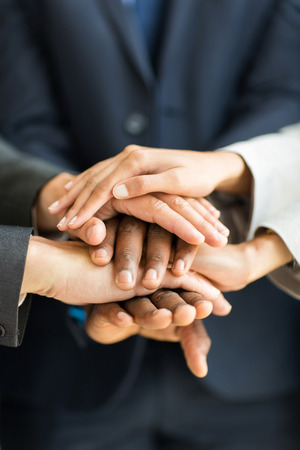 close up of business people hands together photo