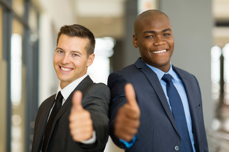 thumbsup: portrait of handsome multiracial business men thumbs up